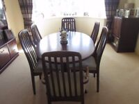 mahogany oval dining table and six chairs