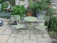 Good quality metal and wood patio set, folding chairs and table, in excellent condition.