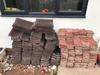 Reclaimed quarry tiles and unused roof tiles. Free