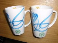 Two collectable McDonald's mugs.