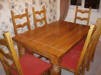 oak dining room table and 6 chairs ,sale due to house move ,would take with us , but wont fit