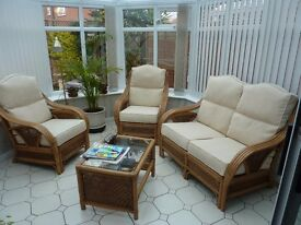 Cane Conservatory Suite with beige cushions and matching coffee table all in excellent condition