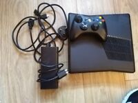Black Xbox 360 arcade - controllers, cables and games
