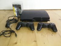PS3 Console with 2 Controllers and 6 Games