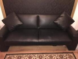 Black faux leather sofa bed with 2 cushions