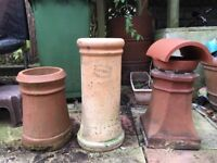 3 x chimney pots, one with cowl