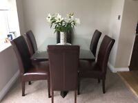 SOLD - - - - Glass Dining Table and 6 leather chairs
