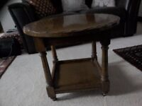 Dark solid wood round coffee table