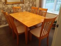 Extending Dining Table with 6 Chairs. Hardly used excellent condition.