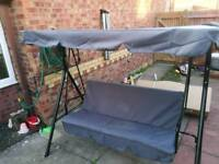 3 seater garden swing,nearly new just taken from box