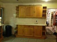 Kitchen cupboards with worktop and built in fridge