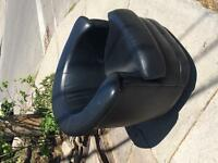 Black leather tub chair swivels and rocks