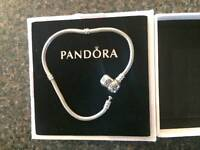 Pandora silver bracelet and 6 charms for sale!