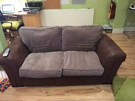 DFS Leather and fabric 2 seater sofa and armchair with storage foot stall