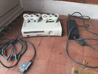 Xbox 360 and two controllers plus games
