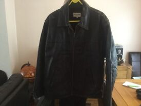 Black leather jacket size medium in brand new condition