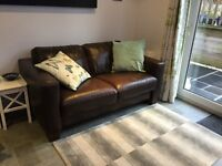 Brown leather sofa, 2 seater, good condition from a smoke free home