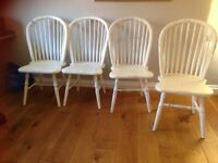 Shabby chic 4 large white chairs. Beautiful solid chairs.