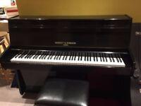 Black Barrett & Robinson Upright Piano