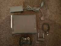Xbox 360, Kinect, Camera, wireless adapter, controller and 12 Games.