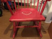 For sale Beautiful vintage looking rocking chair in vintage red in excelent condition.