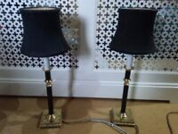 Two Brass table lamps with black stems and blck silk lampshades