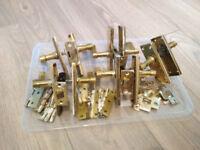 Set of bronze door handles, latches, hinges