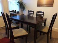 Good condition Marrakesh Dining Table and 6 chairs
