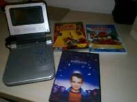 SOLD Portable DVD player with 3 DVD's