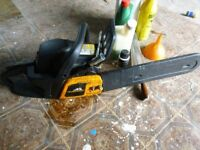 McCulloughs chainsaw with oils and chain sharpener