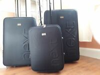 A set of 3 genuine next suitcases black in colour never been used.