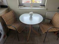 Dining table and 2 chairs.