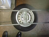 Caravan spare wheel and carrier for Alko chassis.