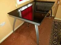 Black extendable tempered glass dining table