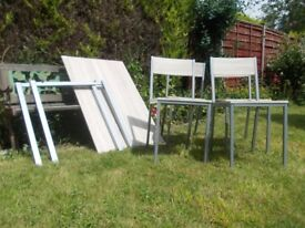 Dinning table and 4 chairs (new)