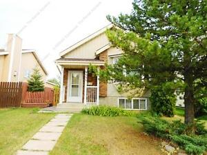 IDEAL 4-BDRM BI-LEVEL HOME WITH DETACHED DBLE GARAGE IN LA PERLE