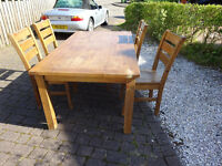 Wooden Dining table and 4 chairs (no veneer in ere)