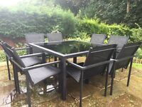 Outdoor black glass table and chairs furniture set