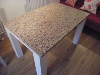 granite topped wooden table with additional wooden oval top