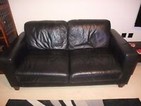 2 BLACK FAUX LEATHER SOFAS AND FOOT STOOL