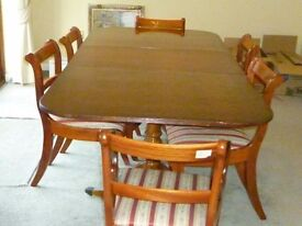 Dining table and 6 chairs, including 2 carvers