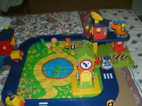 Early Learning Centre Village, with buildings cars and figures