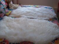 2 acrylic fur sheepskin style rugs 2ftx3ft,never used