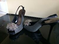Silver and black evening shoes
