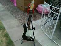 Electric guitar strat copy and stand garage find