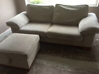 Large beige sofa and footstool for sale