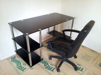 Computer Desk and chair. Glass and metal desk. Leather swivel chair.