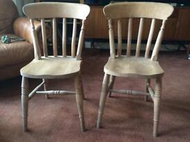 Two vintage solid wood chairs