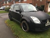 2009 Suzuki swift with rare red leather seats