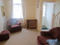 Large double room for male in two bedroom house close to city centre near transport routes .